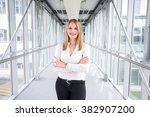 businesswoman standing in a... | Shutterstock . vector #382907200