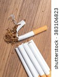 Small photo of cigarette stop smoking detrimental on wood background