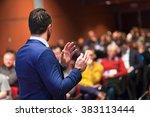 Public Speaker Giving Talk At...