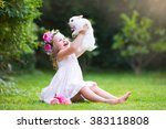 girl playing with real rabbit... | Shutterstock . vector #383118808