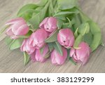 bunch of pink tulips on wooden... | Shutterstock . vector #383129299