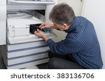 man fixing cartridge in... | Shutterstock . vector #383136706