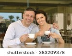 happy couple with coffee | Shutterstock . vector #383209378