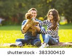 Stock photo lifestyle happy family of two resting at a picnic in the park with a dog 383300410