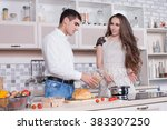 man and woman in the kitchen... | Shutterstock . vector #383307250