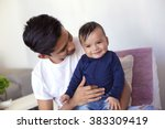 young mexican father takes care ... | Shutterstock . vector #383309419