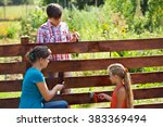 woman and kids painting the... | Shutterstock . vector #383369494