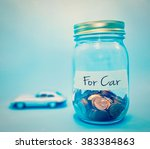 coins in bottle on blue... | Shutterstock . vector #383384863