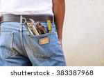 tools in man's jeans back... | Shutterstock . vector #383387968