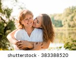 Small photo of Mature mother hugging with her teen daughter outdoor in nature on sunny day