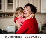 happy senior woman hugging her... | Shutterstock . vector #383393680