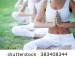 Group Of Women Doing Yoga At...