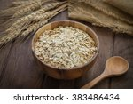 oat flakes in wooden bowl and... | Shutterstock . vector #383486434