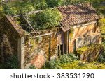 Small photo of A very old house with the grass on its roof in Nepal.People might have left it during the maoist insurgency period a few years back.