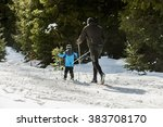 Little Boy On Skis With Father...