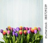 Stock photo bunch of tulips on the bright board 383729239