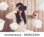 woman in virtual reality helmet.... | Shutterstock . vector #383822344