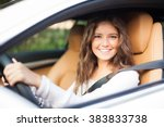 young woman driving her car | Shutterstock . vector #383833738