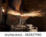 The Blacksmith Manually Forging ...