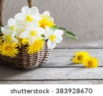 Spring Flowers In Basket On...