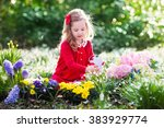 Child Planting Spring Flowers...