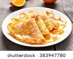 crepes suzette on white plate...   Shutterstock . vector #383947780