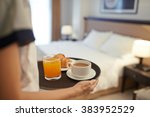 Stock photo waitress bringing breakfast to the hotel room 383952529