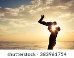father and son playing on the... | Shutterstock . vector #383961754