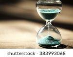 hourglass on wooden background... | Shutterstock . vector #383993068