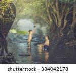 children swim in the streams | Shutterstock . vector #384042178