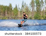 young man riding wakeboard on a ... | Shutterstock . vector #384100573