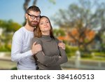 cheerful young couple standing | Shutterstock . vector #384160513