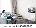 young beautiful woman watching... | Shutterstock . vector #384182800