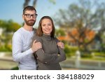cheerful young couple standing | Shutterstock . vector #384188029