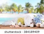 spa and massage setting on wood ... | Shutterstock . vector #384189409