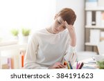 tired businesswoman sitting at...   Shutterstock . vector #384191623