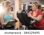 working with personal trainer... | Shutterstock . vector #384229690