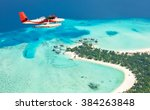 sea plane flying above maldives ... | Shutterstock . vector #384263848