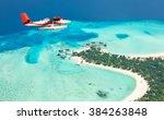 Sea Plane Flying Above Maldive...