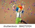 little boy in clown wig jumping ...   Shutterstock . vector #384271924