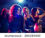 Stock photo party holidays celebration nightlife and people concept smiling friends dancing in club 384285400