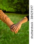 couple holding hands in a... | Shutterstock . vector #38429197