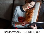 happy young woman drinking...   Shutterstock . vector #384318100