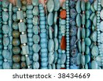 Beautiful turquoise gemstone necklaces on display on the market - stock photo