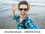 handsome caucasian guy takes a... | Shutterstock . vector #384352516