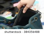 close up on  hand pickpocketing ... | Shutterstock . vector #384356488