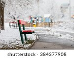 Red Bench In A Snowy Park ...