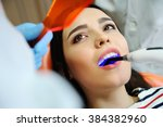 beautiful girl at the dentist.... | Shutterstock . vector #384382960