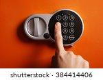 finger on digital lock of safe | Shutterstock . vector #384414406