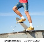 cool skateboard is jumping high ... | Shutterstock . vector #384449650